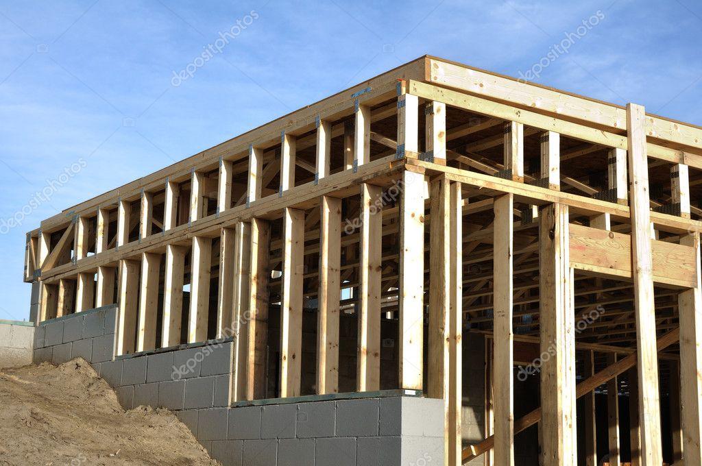 View of framed walkout basement walls stock photo for Walkout basement construction