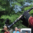 Постер, плакат: Marching Band Performer Playing Clarinet in Parade
