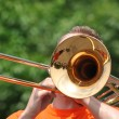 Marching Band Performers Playing Trombones in Parade - Stock Photo