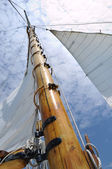 Foresail, Jib, and Wooden Mast of Schooner Sailboat — Stock Photo