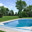 Backyard In-Ground Swimming Pool - Stock Photo