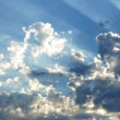 Plane Flying with Sunbeams Through the Clouds — Stock Photo #6633120