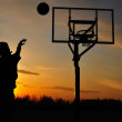 Silhouette of Teen Boy shooting a Basketball — Stock Photo