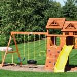 Back Yard Wooden Swing Set — Stock Photo #6633863
