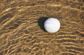 Golf Ball in a Water Hazard — Stock Photo