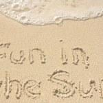 Fun in the Sun Written in Sand on Beach — Stock Photo