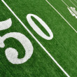 View From Above of Fifty Yard Line on American Football Field - Stock Photo