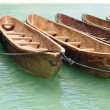 Stock Photo: Canoes Tied Together Near Beach