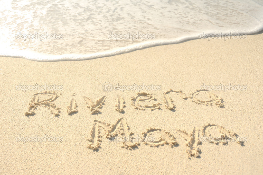 The Phrase Riviera Maya Written in the Sand on a Beach  Stock Photo #6641350