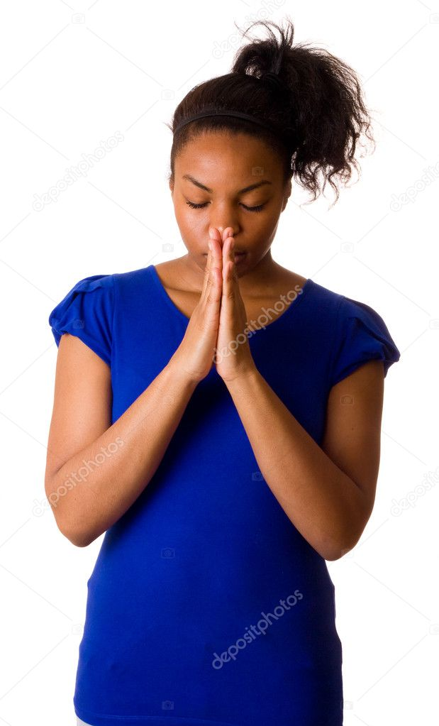 A young woman praying isolated on a white background.  — Stock Photo #6094479