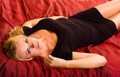 Woman lying on bed. — Stock Photo