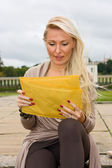 Woman reading post — Stock Photo