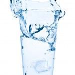 Water splash in glass — Stock Photo