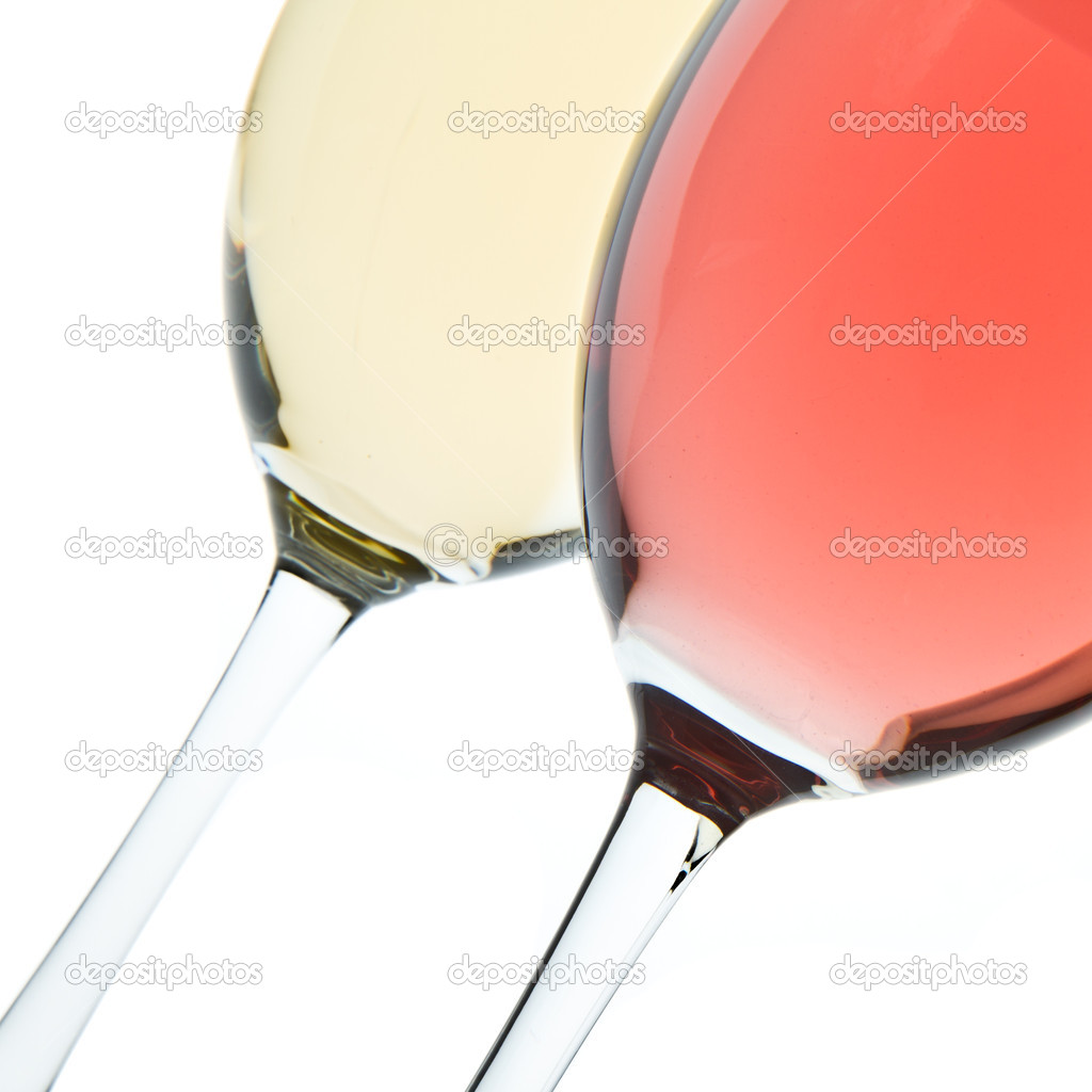 Two wine glasses with white and rose wine — Stock Photo #5733997