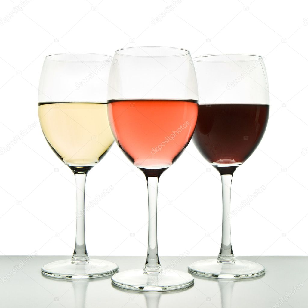 Three glasses with white, rose and red wine  Stock Photo #5734037