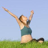Pregnant woman on meadow — Stock Photo