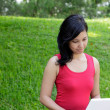 Woman in park with laptop — Stock Photo #5385280