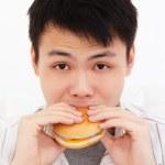 Man eating a burger — Stock Photo