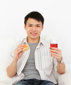 Man with burger and drink — Stock Photo