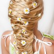 Camomiles in hair — Stock Photo