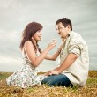 The woman and the man in the field — Stock Photo