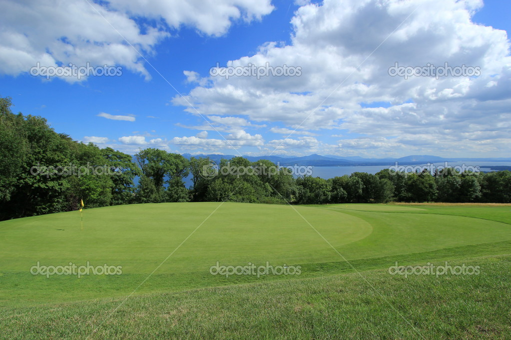 Golf course by Geneva lake by cloudy weather, Switzerland — Stock Photo #6164175