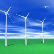 Wind turbines and green grass — Stock Photo