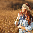 Beautiful Woman on a Field in Summertime — Stock Photo #5984205