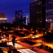 Timelapse Image of Los Angeles freeways at sunset - Stock Photo