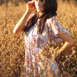 Beautiful Woman on a Field in Summertime — Stock Photo