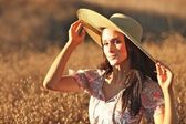 Young Beautiful Woman on a Field in Summer Time — Stock Photo