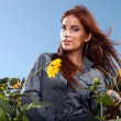 Red Haired Woman Outdoors in a Sunflower Field — Stock Photo