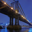 Stock Photo: Brooklyn Bridge and Manhattan Skyline At Night NYC