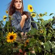 Red Haired Woman Outdoors in a Sunflower Field - Stock Photo