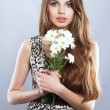 Stock Photo: Beautiful lady with flowers bouquet