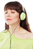 Piękna dziewczyna z zielonej słuchawki — Zdjęcie stockowe