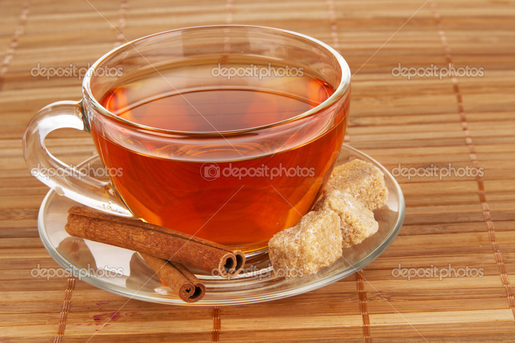 Tea with honey, lemon and cinnamon on bamboo pad — Stock Photo #5688933