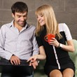 Young man and woman sitting with a laptop — Stock Photo