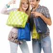 Royalty-Free Stock Photo: Beautiful young couple with shopping bags