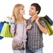 Cheerful couple with shopping bags — Stock Photo