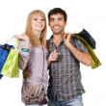 beau jeune couple avec des sacs à provisions — Photo