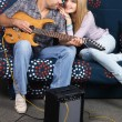 Romantic couple with electric guitar — Stock Photo