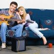 Cheerful couple resting at home — Stock Photo