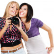 Two lovely friends with a camera — Stock Photo