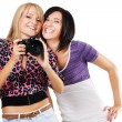 Two lovely friends with a camera — Stock Photo #5726297