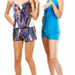 Two fashionable women in colorful clothing - Stock Photo