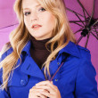 Royalty-Free Stock Photo: Pretty woman in blue coat with umbrella