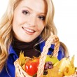 Lovely woman with a basket of ripe fruits — Stock Photo