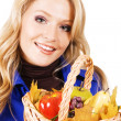 Lovely woman with a basket of ripe fruits — Stock Photo #5726432