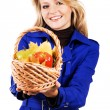 Lovely woman with a basket of ripe fruit — Stock Photo